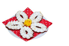 Easter meringue cookies on a white plate with a red napkin Stock Photography