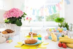 Easter morning breakfast. Eggs decor table setting. Easter breakfast table setting. Decoration for Easter family celebration. Eggs basket and spring flowers royalty free stock photography