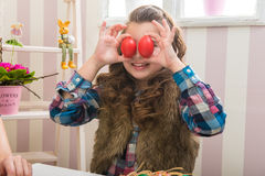 Easter - Mother and daughter funny eyes than eggs Royalty Free Stock Photo