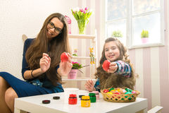 Easter - Mother and daughter painted with egg Royalty Free Stock Photo