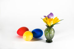 Easter motive,. Three eggs with colours in a small vase on a white background Royalty Free Stock Photos