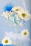 Easter motive. Photo of Easter eggs and flowers on blue background Stock Image