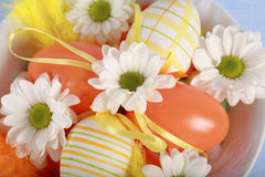 Easter motive. Photo of Easter eggs and flowers on blue background Royalty Free Stock Images