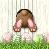 Easter motive, bunny bottom andeaster eggs in fresh grass on white wooden background, illustration stock illustration