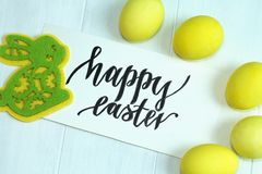 Easter multicolored eggs and a yellow-green toy rabbit made of felt, happy Easter. Easter multicolored eggs and a yellow-green toy rabbit made of felt Royalty Free Stock Images