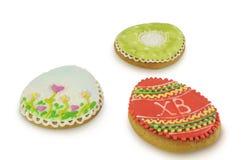 Easter multicoloured spice-cakes like egg isolated on white background Stock Photos