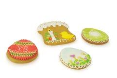 Easter multicoloured spice-cakes like egg isolated on white background Stock Images