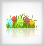 Easter natural background with traditional colorful eggs in gras Stock Image