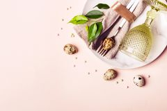 Easter natural table setting on pastel pink background. Beautiful arrangement.  stock photo