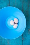 Easter - natural white eggs in a blue bowl Stock Photography