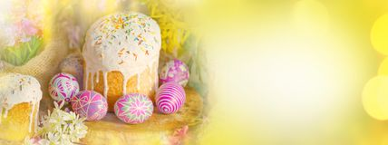 Easter nature holiday background with eggs, Easter cake. Easter bokeh golden shine light background. Decoration with eggs and Easter cake. Easter vintage style Stock Photo