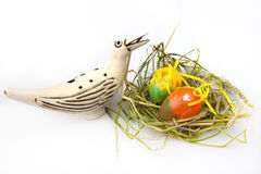 Easter nest. Painted colorful Easter Eggs with bird in a nest on a white background Stock Photography