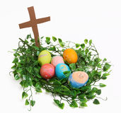 Easter Nest. Eggs nested in front of a cross Royalty Free Stock Photos