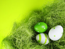 Easter nest (4). Easter nest with green background, colored eggs with green Royalty Free Stock Images