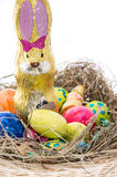 Easter Nest with Candy on white Royalty Free Stock Photos
