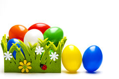 Easter nest with coloured eggs Royalty Free Stock Images