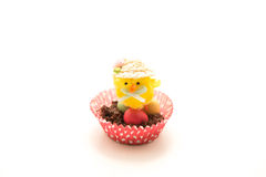 Easter Nest, Egg and Chick. Chocolate Easter nest in a red spotty case with little easter eggs and a yellow chick on top Royalty Free Stock Photo