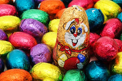 Easter nest with eggs and bunny. Easter nest with colorful chocolate eggs and bunny royalty free stock photography