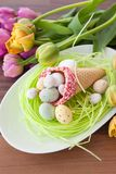 Easter nest and fresh tulips royalty free stock images