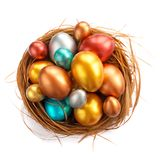 Easter nest with golden eggs. Happy Easter holiday greeting symbol stylish natural wooden grass nest with golden quail eggs isolated on white background royalty free stock photography