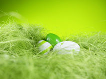 Easter nest with green background (2). Easter nest with green background and three colored eggs Stock Photos