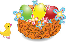 Easter nest with holiday eggs. And a little duck Royalty Free Stock Image