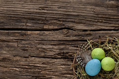 Easter nest on old weathered wood with copyspace Royalty Free Stock Images