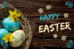 Easter nest on wood with lettering Happy Easter Royalty Free Stock Image