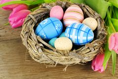 Easter nest on wooden background Royalty Free Stock Photography