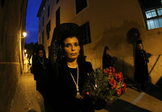 Easter night procession with mourning women Stock Photography