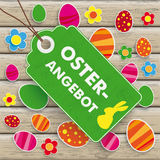 Easter Offer Price Sticker Wood. Infographic with price sticker the wooden background. German text Oster-Angebot, translate Easter Offer Royalty Free Stock Images