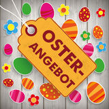 Easter Offer Price Sticker Wooden Wall Stock Image