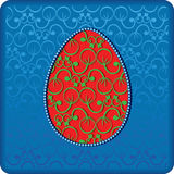 Easter. Ornamental red egg on the lace blue background Royalty Free Stock Images