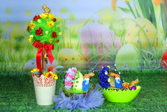 Easter ornaments : basket of easter eggs and a tree. Royalty Free Stock Photo