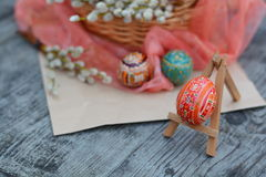 Easter, ornate egg on foreground. Easter, red, ornate egg on foreground on wooden background Stock Images