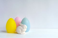 Easter Ostara, Eoster bunny with egg shaped candles Stock Photo