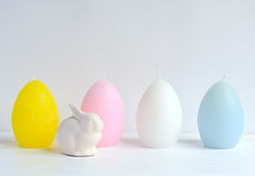 Easter Ostara, Eoster bunny with egg shaped candles Royalty Free Stock Photo