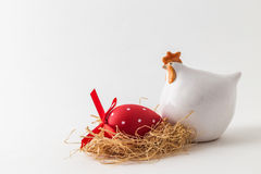 Easter painted egg and porcelain chicken figure Royalty Free Stock Image