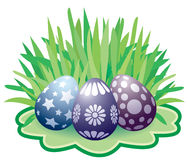 Easter painted eggs. Lying on the grass Royalty Free Stock Image