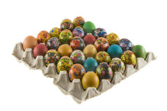 Easter painted eggs. Fresh rural painted eggs are decorated by various techniques before Easter packed into cardboard container.  The imitation of painted eggs Royalty Free Stock Photos