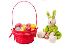 Easter painted eggs in basket with bunny Stock Images
