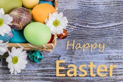 Easter Painted Eggs in Basket stock photography