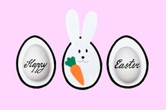 Easter painted eggs and ears of the Easter rabbit-symbols of the Easter holiday stock photo