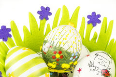 Easter painted eggs in green basket made of fabric Royalty Free Stock Photos