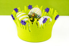 Easter painted eggs in green basket made of fabric Stock Photo