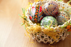 Easter painted eggs in traditional basket Royalty Free Stock Image