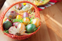 Easter painted eggs in traditional basket Stock Photo