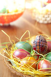 Easter painted eggs on traditional seasonal table Royalty Free Stock Images