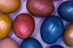 Easter. Easter. Painted Easter eggs on a wooden background with white polka dots and colored ribbons. Top view, closeup. stock image