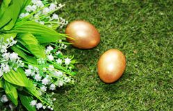Easter. Painted with Golden eggs on grass Royalty Free Stock Photo